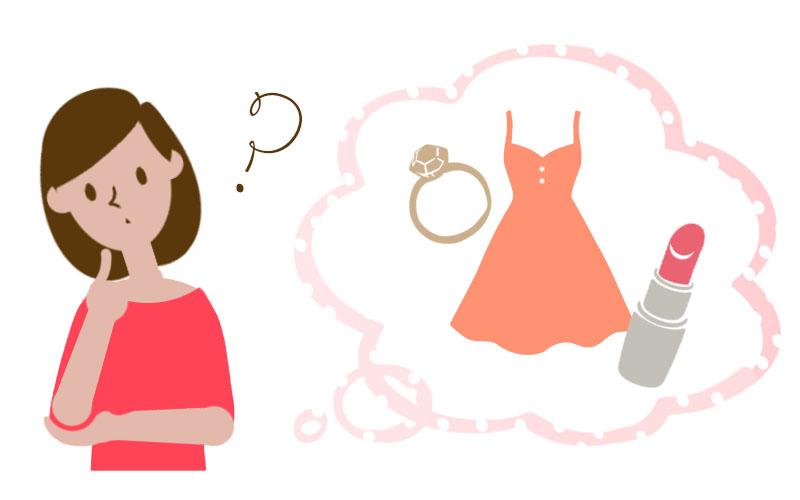 口紅とワンピースと指輪と女性の画像